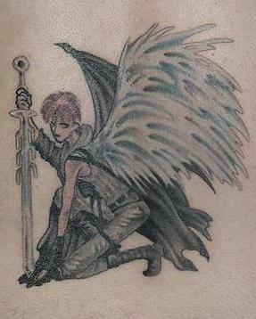 Lower back tattoo, black sitting evil angel