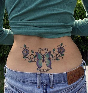Lower back tattoo,allison, beautiful  violet butterfly and flowers