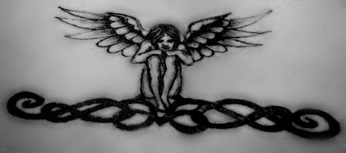 Lower back tattoo,black  sitting angel on chain
