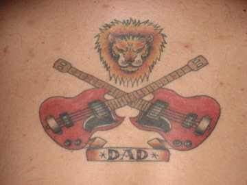 Lower back tattoo, two crossed guitars, angry lion , dad