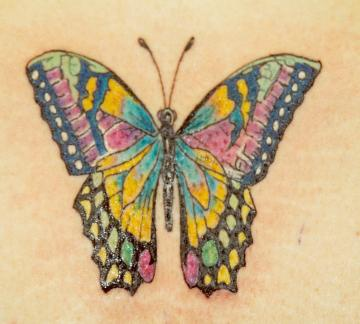 Very colourful butterfly tattoo