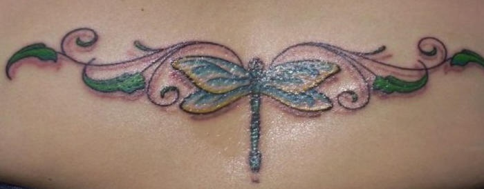 Lower back dragonfly tracery tattoo