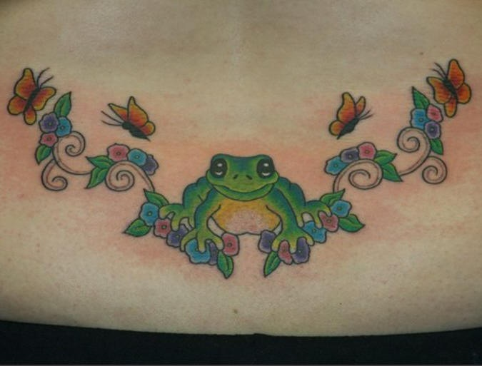 Lower back frog with flower tracery  tattoo