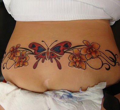 1f9d6b61a099d Lower back orchid with butterfly tattoo - Tattooimages.biz