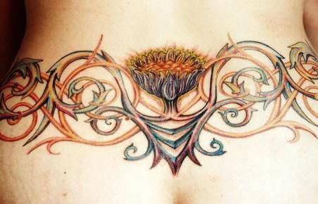 Lower back sunflower vine tattoo