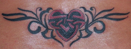 Lower back tattoo, modified black and red heart