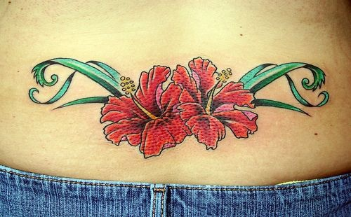 Lower back tattoo, two beautiful red orchids
