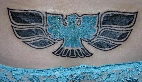 Lower back tattoo design, blue, styled bird, black wings