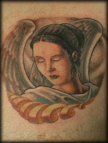 Female angel in sorrow tattoo