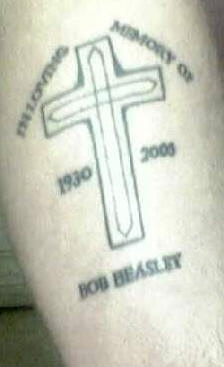 Latin cross in loving memory tattoo