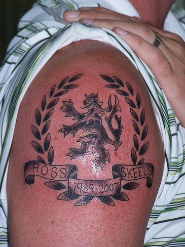 Lion crest memorial tattoo