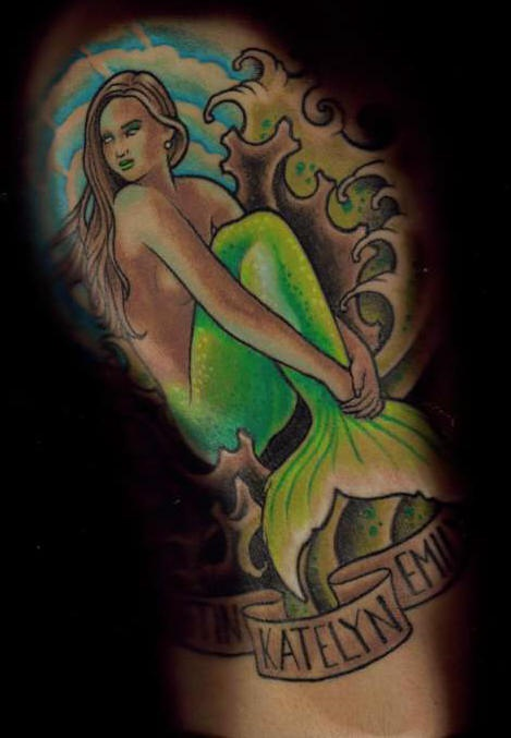 Mermaid in sea lush coloured tattoo