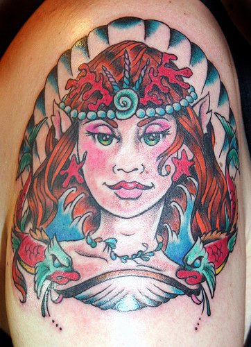 Mermaid portrait with fishes tattoo