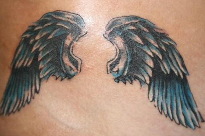 Tattoo of metallic angel wings