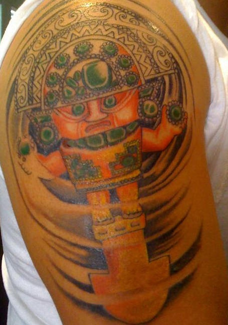Colourful aztec deity tattoo on shoulder