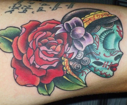 Female sugar skull with rose tattoo