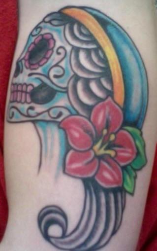 Female dia de muertos skull tattoo