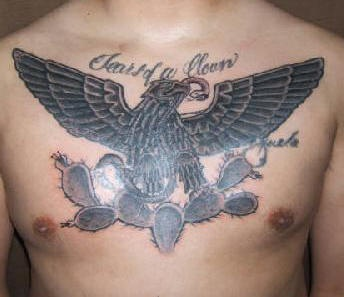 Eagle in cactuses tattoo on chest