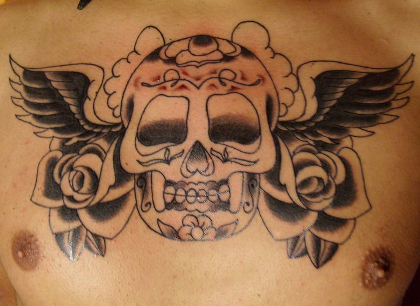 Winged sugar skull with roses tattoo