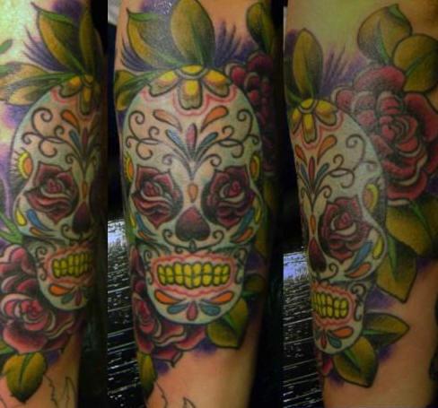 Highly detailed sugar skull tattoo