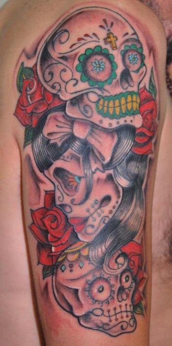 Dia de muertos skulls coloured tattoo