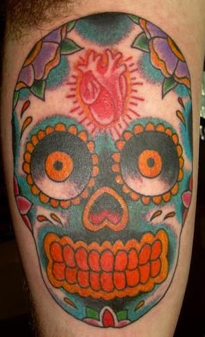 Sugar skull with realistic heart tattoo