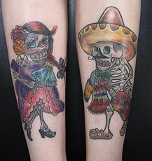 Mexican couple of sugar skeletons tattoos