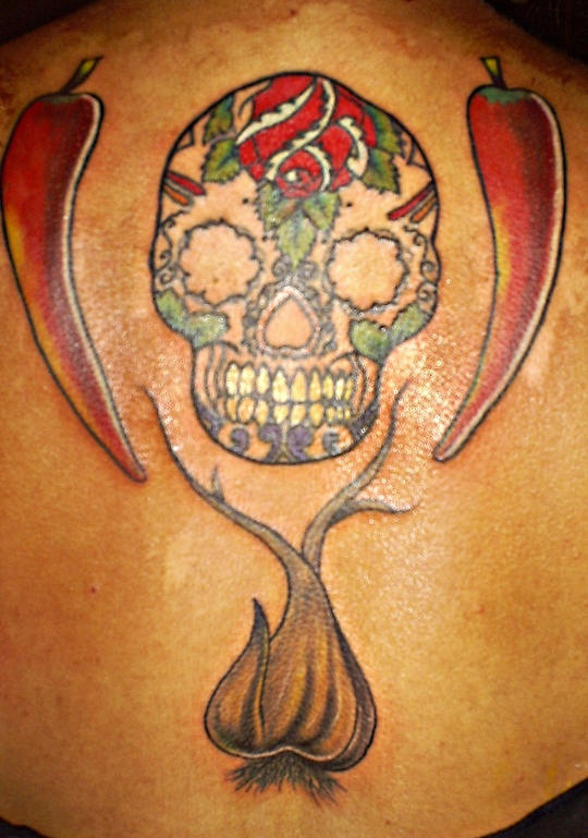 Sugar skull with peppers and garlic tattoo