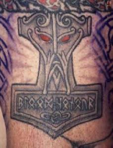 Mjollnir symbol with face tattoo