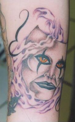Creepy mask with real eyes tattoo