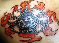 Flaming aztec sun symbol tattoo