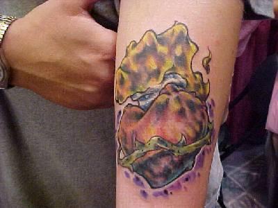 Crumpled sacred heart tattoo