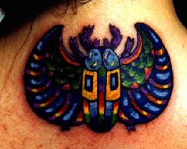 Colourful winged scarab tattoo