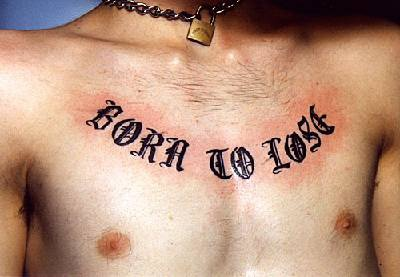 Born to lose tattoo on chest