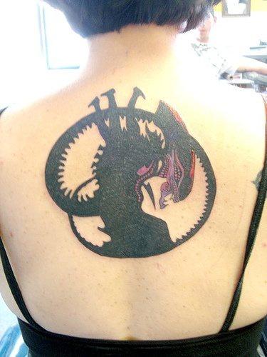 Alien film artwork tattoo on back