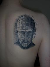 Pinhead tattoo on back