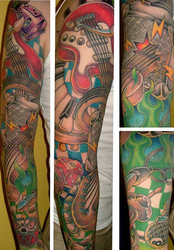 Music instrument themed sleeve tattoo