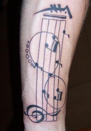 """simbolo di infinita"""" sulle note musicsle tatuaggio"""