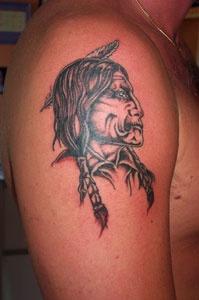 Native american in warpaint tattoo