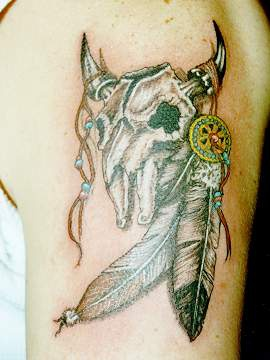 Bull skull with feathers talisman tattoo