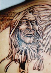 Nero inchiostro pelle rossa capopopolo tatuaggio