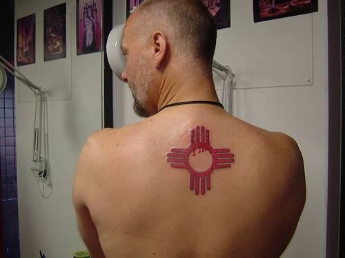 Tribal indian symbol tattoo on back
