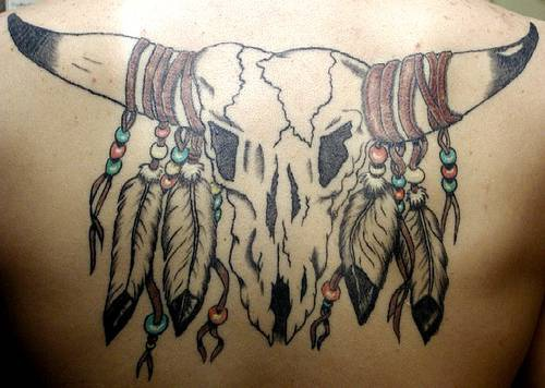 Bull skull with feathers tattoo