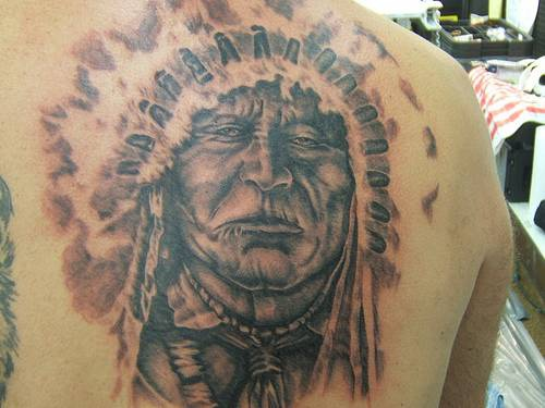 Big chief in feather crown tattoo