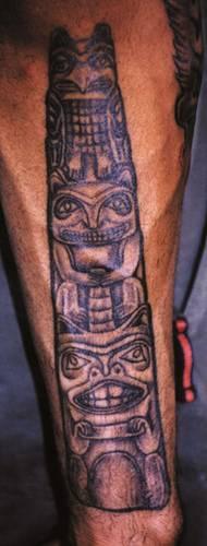 Indian animal totem pole tattoo