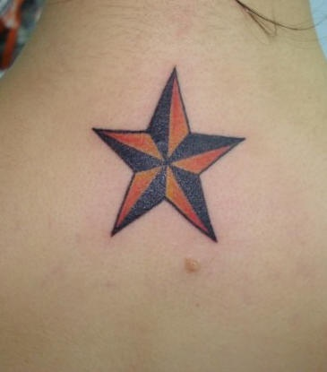 Red and black star tattoo on neck