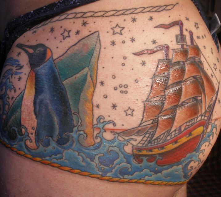 Sailing vessel in antarctica with penguins tattoo