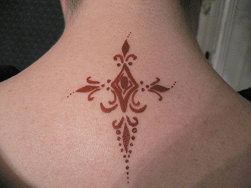 Middle age cross tattoo