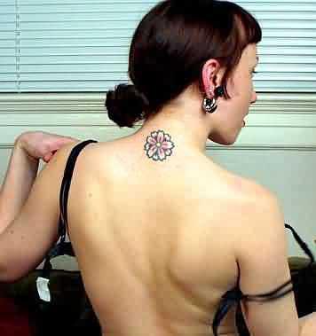 Girly flower tattoo on neck