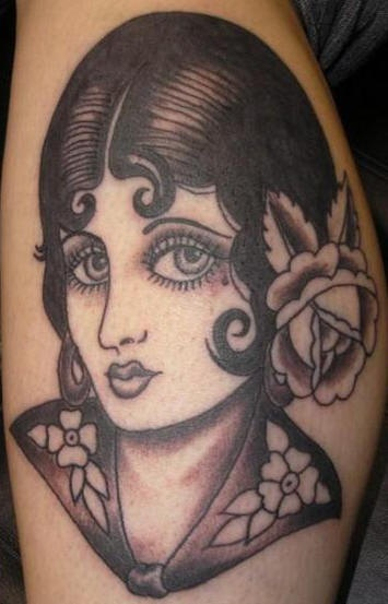 Old school pin up girl black ink tattoo for Traditional pin up tattoos